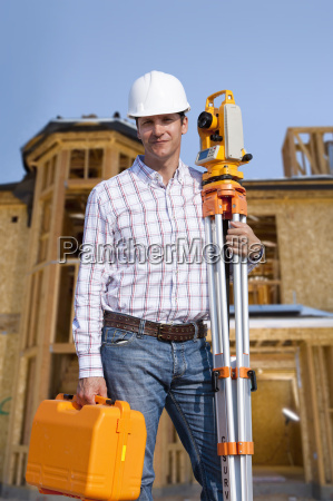 portrait of architect with theodolite on