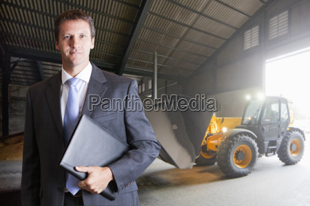 portrait of businessman in farm grain