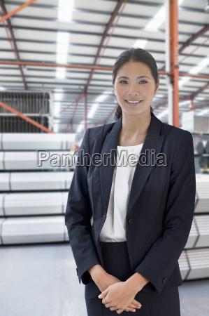 businesswoman in steel store of engineering