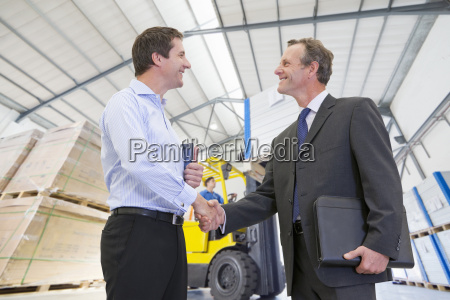 businessman meeting in solar panel manufacturing