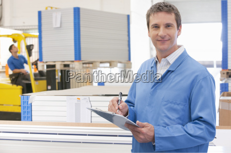 worker in solar panel manufacturing warehouse