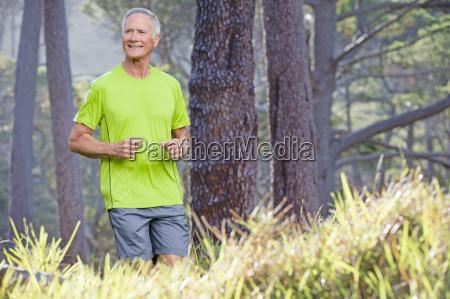 senior man exercising with run in
