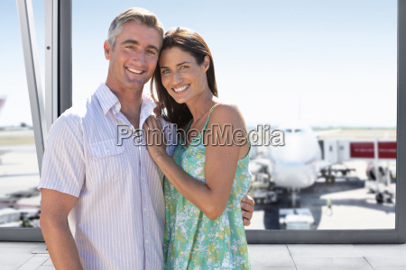 portrait of mature couple in airport