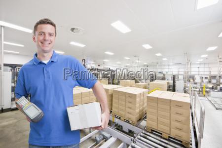 portrait of worker using scanner in