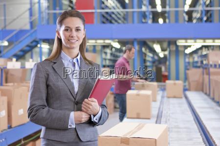 portrait of businesswoman in warehouse despatch