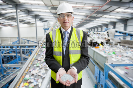 businessman, in, recycling, plant, holding, plastic - 20515407