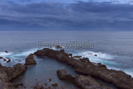 lava rock coast at dawn at