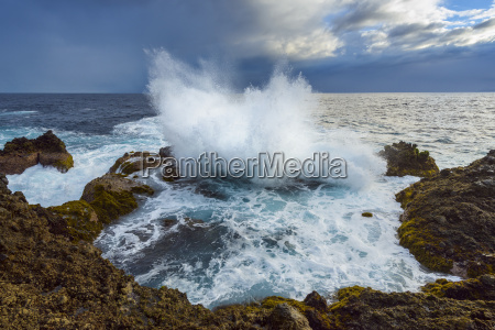 lava rock coast at sunrise with