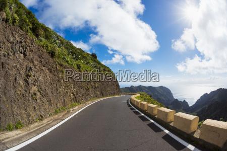 mountain pass road with sun teno