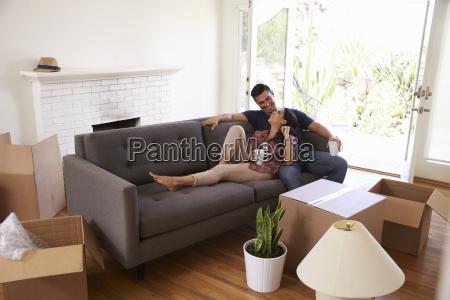 couple on sofa taking a break