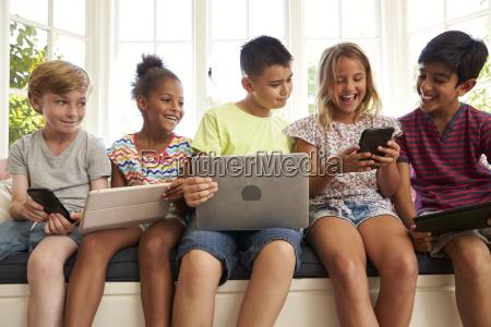 group of children sit on window
