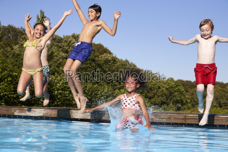 group of children jumping into outdoor