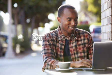 young black man using a laptop