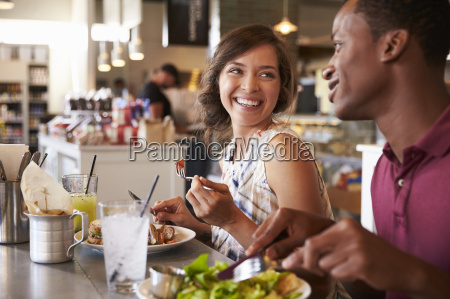 couple enjoying lunch date in delicatessen