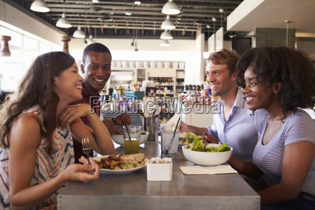 friends enjoying lunch date in delicatessen
