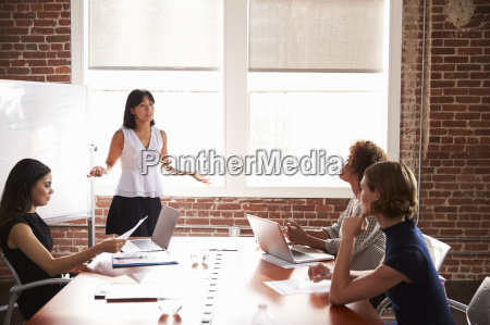group of businesswomen meeting in modern