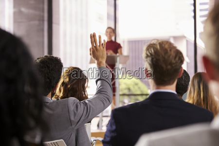 presenter at business seminar takes a