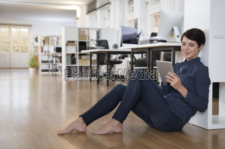 woman sitting on floor in office