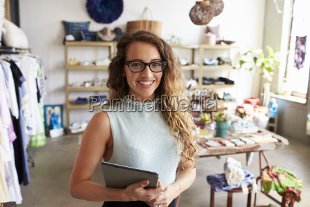 female business owner holding tablet computer