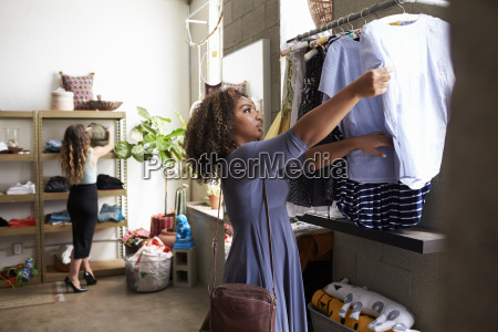 mixed race female customer clothes shopping