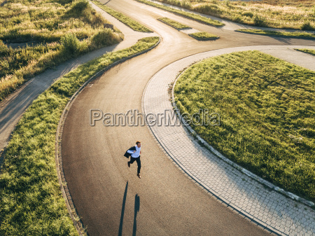 businessman running in roundabout