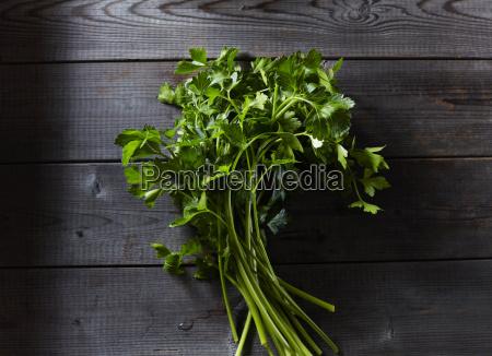 flat leaf parsley on dark wood