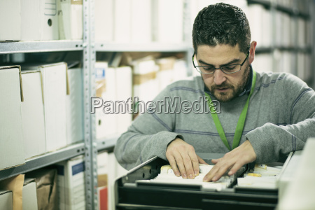 man searching for files in an