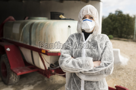 woman wearing protective overall to fumigate