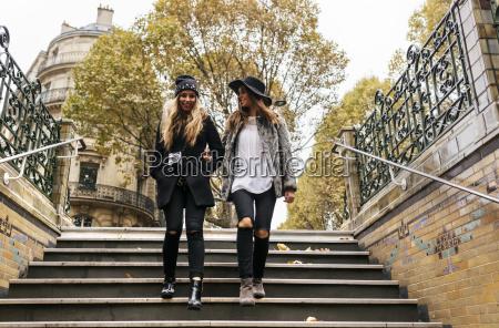 paris france two young women walking