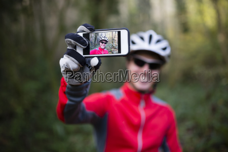 mountain biker taking selfie with his
