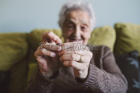 hands of senior woman sitting on