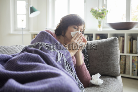 woman having a cold lying on