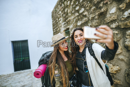 two happy young women taking a