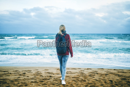 young woman at the seashore in