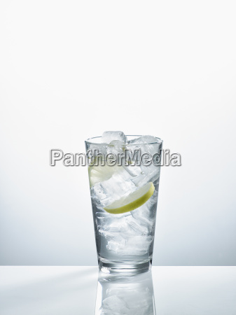 glass with mineral water ice cubes
