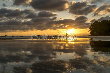 myanmar sunset at beach of ngwesaung