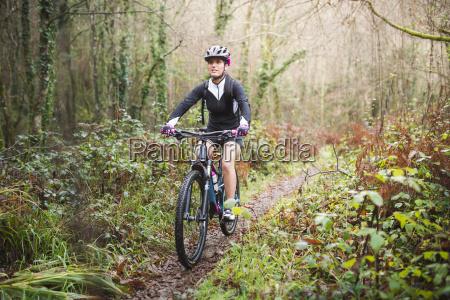 female mountain biker riding her bike