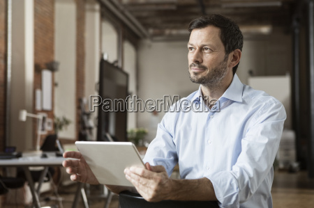 businessman using tablet in office