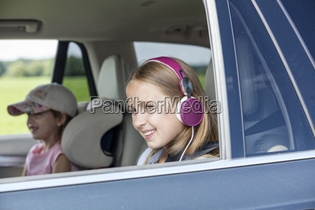 girl sitting in car looking out
