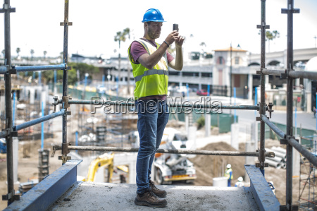 construction worker on construction site taking