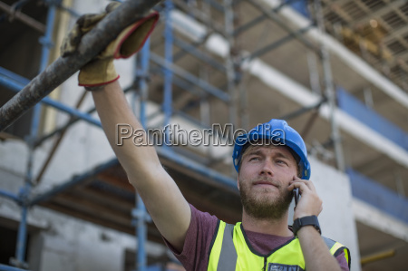 construction worker on construction site talking