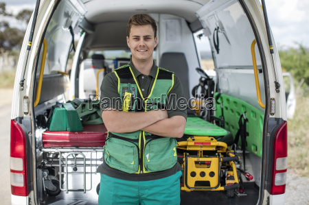 paramedic standing with arms crossed in
