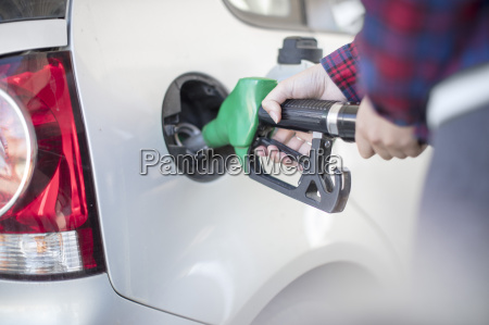 woman fueling car