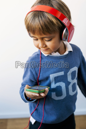 little boy listening to music with