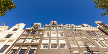netherlands amsterdam row of facades of
