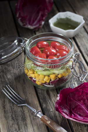 preserving jar of salad with different