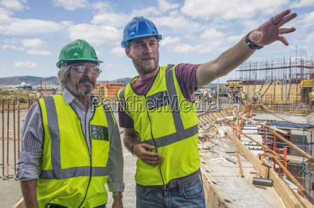 construction worker talking to man on