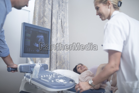 doctor in hospital doing sonogram with