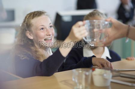 teenage girls in high school cooking