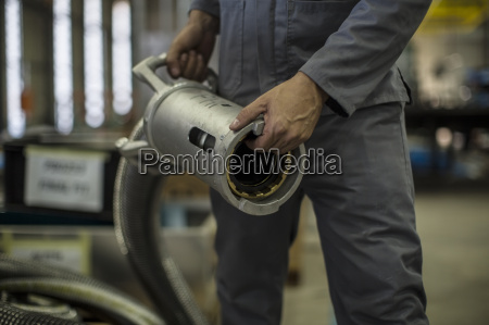 close up of worker holding industrial